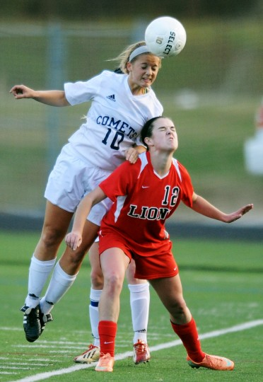 Catonsville's Allison Dingle, left, goes up for a header over Dulaney's Elizabeth Mathey during the regional quarterfinals at Catonsville High School on Tuesday, Oct. 29, 2013. (Jon Sham/BSMG)