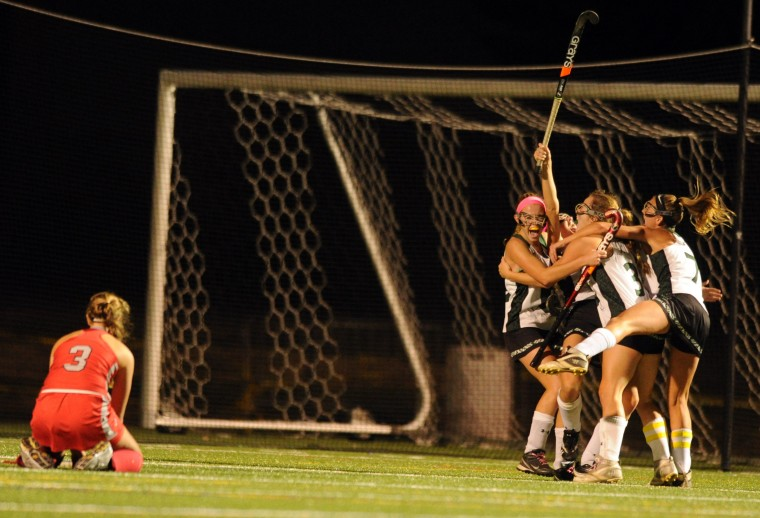 Century players celebrate their sudden victory goal as Molly Milani of Glenelg reacts to the 3-2 double overtime loss during the 2A state semifinal field hockey game at Broadneck High School on Wednesday, November 6, 2013. (Brian Krista/BSMG)