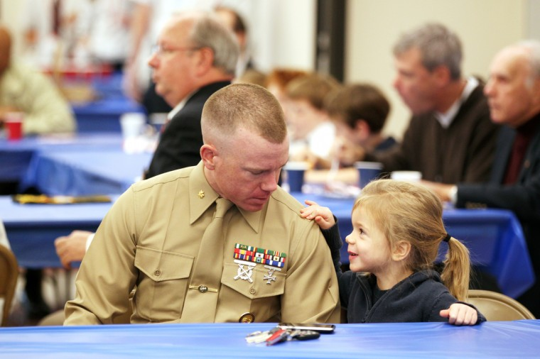 Rowan Hurley, 4, of Severn talks to her father Resurrection-St. Paul School alumni and Marine Corps Maj. Sean Hurley, left, during a breakfast for Veterans Day at Resurrection-St. Paul School in Ellicott City, MD on Monday, November 11, 2013. (Jen Rynda/BSMG)