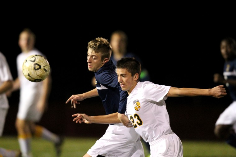 River Hill's Michael Heitzmann, left, Mt. Hebron's Brady Burman-Magday, right, during the boys soccer region final game at Mt. Hebron High School in Ellicott City on Tuesday, November 5, 2013. (Jen Rynda/BSMG)