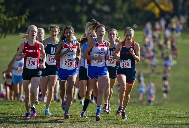 The lead pack crests the first hill during the 3A Girl's Cross Country State Championship Meet at McDaniel College in Westminster on November 9, 2013. (Scott Serio/BSMG photo)