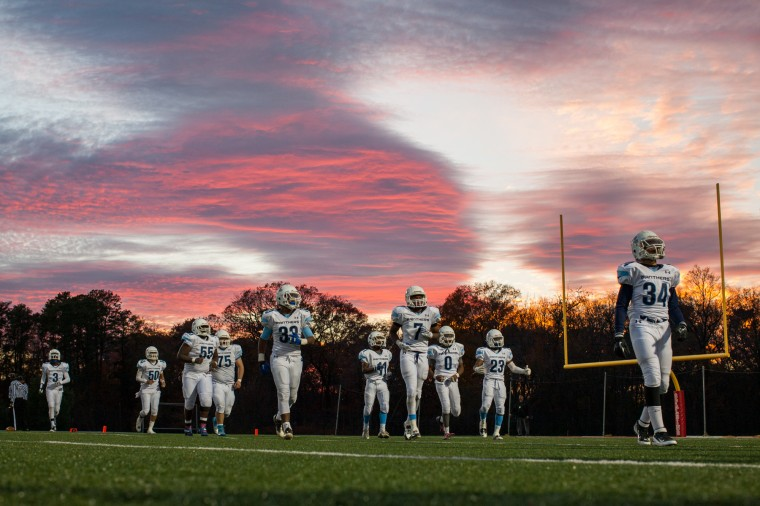 Pallotti players walk off the field under a colorful sky after losing to St. Catholic Prep of Frederick in the MIAA Conference Championship game at Archbishop Spalding. (Nate Pesce/BSMG photo)
