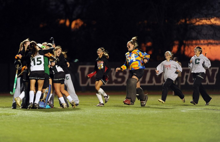 Century players rush the field to surround their goalie after defeating Hereford 2-0 during the Class 2A state field hockey championship game at Washington College in Chestertown on Saturday, November 9, 2013. (Brian Krista/BSMG)