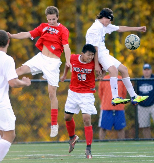 From left, Dulaney's Keegan Colegrove and David Chong battle Perry Hall's Jack Muller for a ball in the second half of a Class 4A regional semifinal soccer game Friday, Nov. 1, 2013, in Perry Hall. (Photo by Steve Ruark)