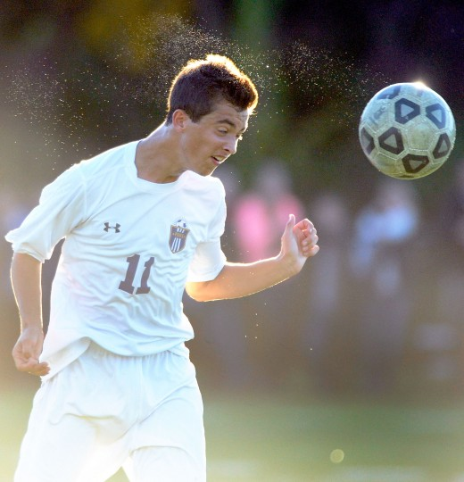 Perry Hall's Colin Weyant heads a ball against Dulaney in the first half of a Class 4A regional semifinal soccer game Friday, Nov. 1, 2013, in Perry Hall. (Photo by Steve Ruark)