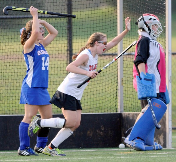 Dulaney's Cristina Lopez, center, and Old Mill's Sam Kiser, left, and goalkeeper Talia Parrish, right, react after Dulaney's Casey Profrock, not pictured, scored the lone goal in Dulaney's 1-0 overtime victory in a Class 4A regional field hockey final Wednesday, Oct. 30, 2013 at Meadowood Regional Park in Baltimore. (Photo by Steve Ruark)