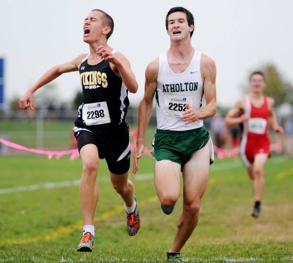 Mt. Hebron's Ryan Huett, left, and Atholton's Bryce Rosicky try to beat each other to the finish line in the boys race at the Cross Country 3A Regional finals at Centennial High School on Thursday, Oct. 31, 2013. (Jon Sham/BSMG)