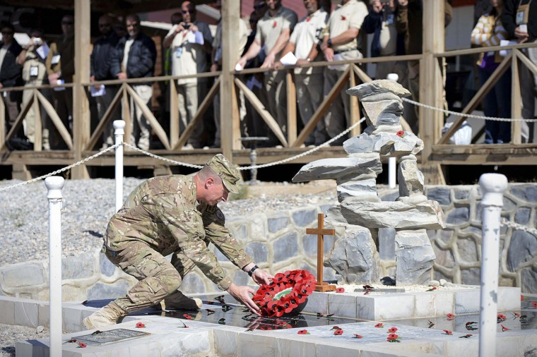 Commander of Kandahar Airfield (COMKAF), Brigadier General John Dolan lays a wreath on Armistice Day at the memorial in Kandahar Airfield November 11, 2013, in this handout provided by the Ministry of Defence (MoD). (Sergeant Dan Bardsley (Phot)/Ministry of Defence (MoD)/ Reuters)