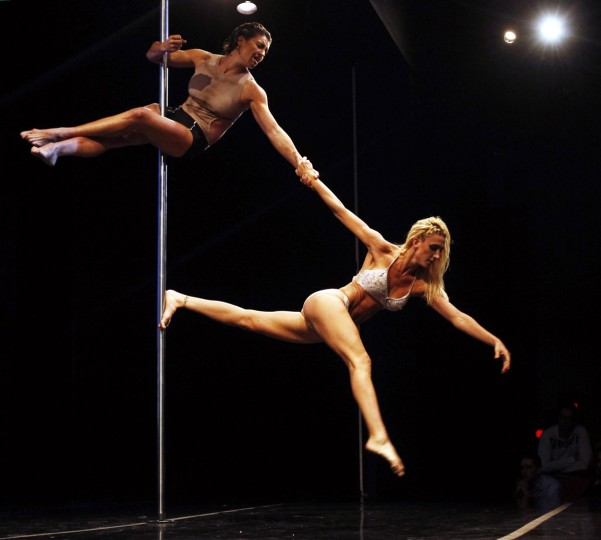 Ekaterina Malykhina and Tallyta Torres of Brazil perform during the doubles category at the Miss Pole Dance South America 2013 competition in Buenos Aires November 25, 2013. (Agustin Marcarian/REUTERS)