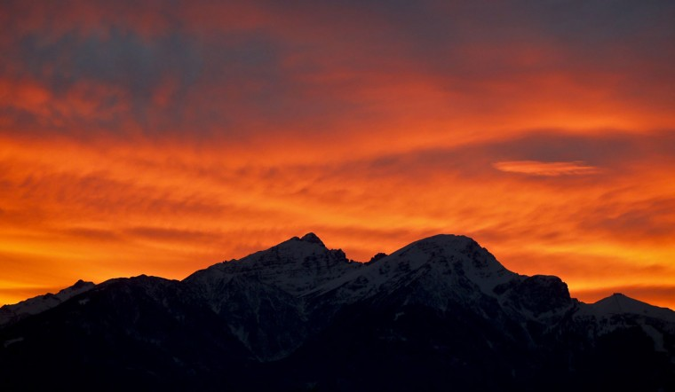 The snow covered mountain summits of Serles mountain and Mutterer Alm mountain are seen during sunset in the western Austrian village of Absam November 29, 2013. (Dominic Ebenbichler/REUTERS)