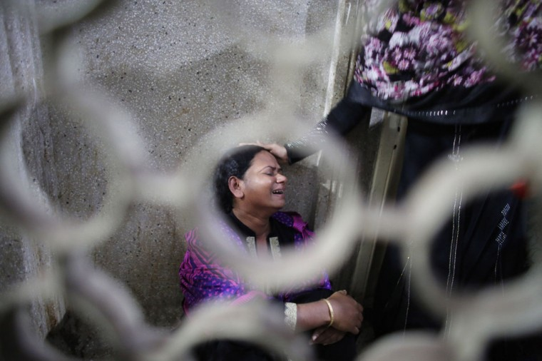 Nasima cries after her mother Monowara Begum, 55, was injured by a crude bomb, in Dhaka Medical College Hospital November 26, 2013. Bangladeshi opposition supporters detonated scores of homemade bombs and removed railway tracks to disrupt train services on Tuesday as a planned nationwide protest against upcoming elections turned violent, witnesses and police said. (Andrew Biraj/REUTERS)