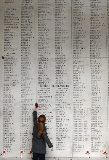 A girl looks at the names of Commonwealth soldiers who died in World War One during a Last Post ceremony at the Menin Gate Memorial in Ypres, November 11, 2013. (Francois Lenoir/Reuters)