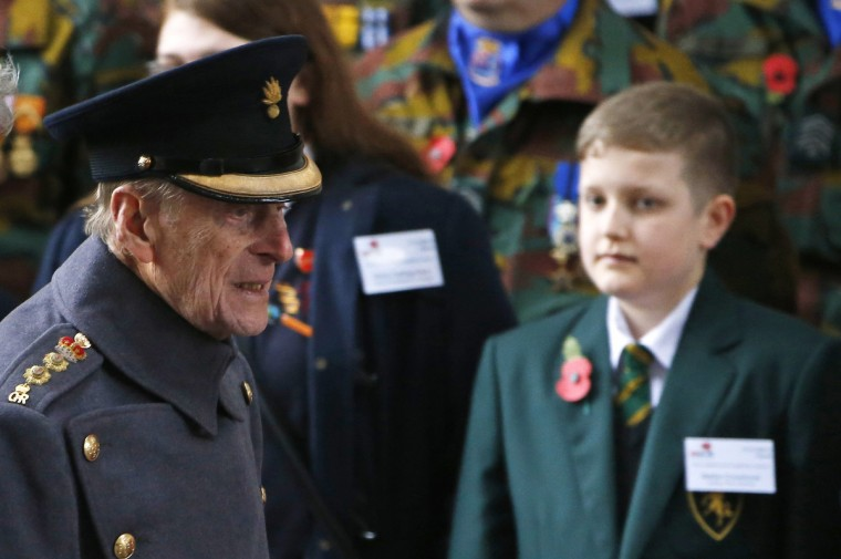 Britain's Prince Philip (L), Duke of Edinburgh, attends a Last Post ceremony at the Menin Gate Memorial in Ypres, November 11, 2013. (Francois Lenoir/Reuters)