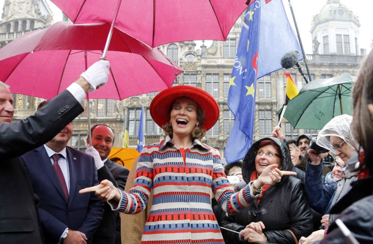 Belgium's Queen Mathilde reacts as she greets the crowd during the Joyous Entry, a local name used for the royal entry, at Brussels' Grand Place. A formal first visit to a city by an inheritor of the throne of Belgium upon his accession is referred to as a Joyous Entry. (Francois Lenoir/Reuters)