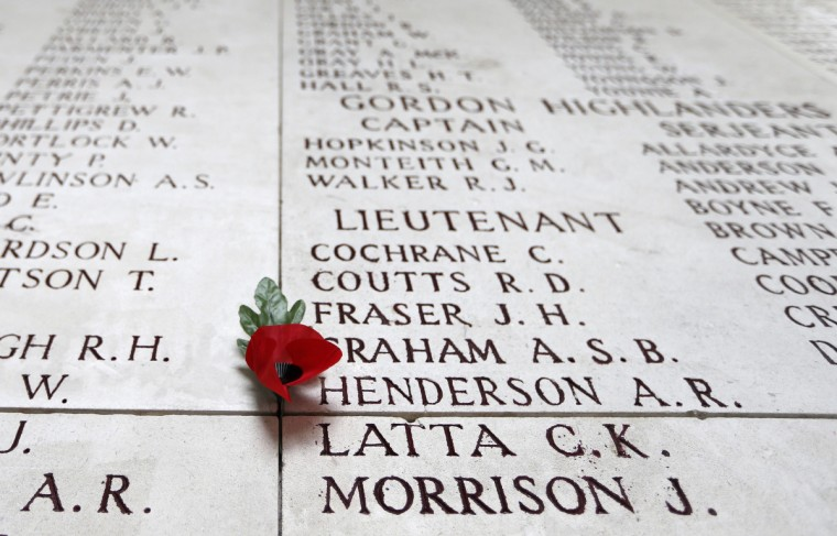 A poppy lies atop engraved names of Commonwealth soldiers who died in World War One, during a Last Post ceremony at the Menin Gate Memorial in Ypres, November 11, 2013. (Francois Lenoir/Reuters)