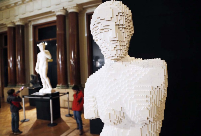 """An art work titled """"Venus de Milo,"""" constructed out of 18,483 Lego bricks, is seen during """"The Art of the Brick"""" exhibition at the Brussels Stock Exchange November 25, 2013. The exhibition featuring large Lego art works by U.S. Lego artist Nathan Sawaya will run till April 21, 2014. (Francois Lenoir/Reuters)"""