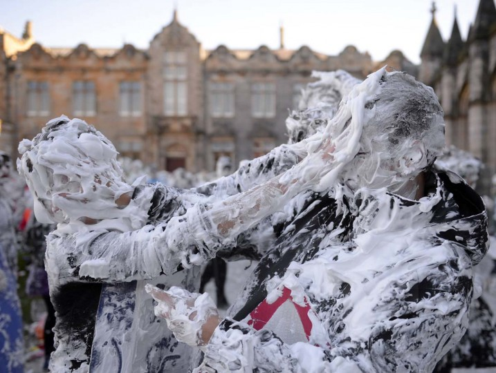 Students from St Andrews University are covered in foam as they take part in the traditional 'Raisin Weekend' in the historic St Salvator's Quad, in St Andrews, Scotland November 4, 2013. The weekend, which begins on Sunday, involves rituals for new students, culminating in a foam fight on Monday morning. (Russell Cheyne/Reuters)