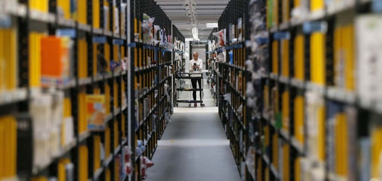 A member of staff pushes a trolley as she collects orders at the Amazon fulfilment centre in Peterborough, central England November 28, 2013. The centre is preparing for Cyber Monday, which is considered the busiest day for online shopping in Britain and will fall on Monday, December 2 this year. Reuters photo by Phil Noble