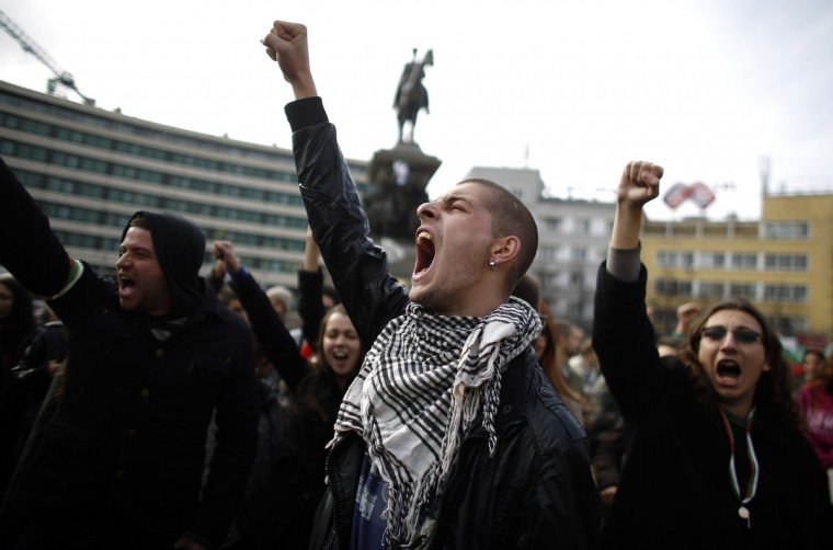 Bulgarian students shout anti-government slogans during a protest in front of the parliament in central Sofia. Five protesters were detained following scuffles with riot police in front of the Bulgarian parliament on Tuesday, in the latest escalation of street demonstrations against the Socialist-led government. (Stoyan Nenov/Reuters)