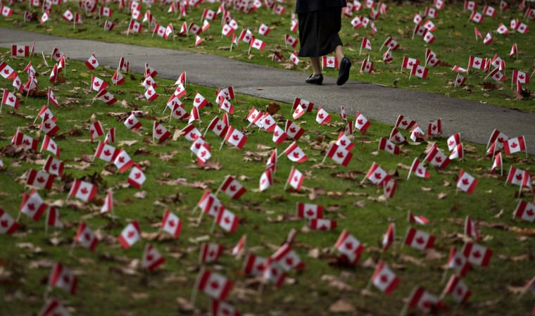 Canadian flags in honor of Remembrance Day cover the property of a seniors home in Burnaby, British Columbia November 10, 2013. Students from a local school planted 5,000 flags around the home that houses about 300 Armed Forces veterans. (Andy Clark/Reuters)