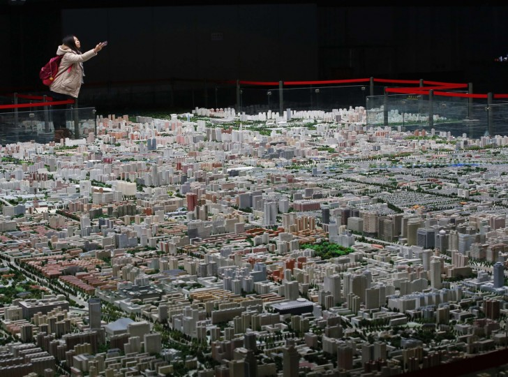 A visitor takes pictures of a model of Beijing's downtown at the Beijing Planning Exhibition Hall, a museum showcasing the achievement of Beijing urban planning construction, in Beijing. In defying four years of official cooling efforts, China's soaring house prices reveal an uncomfortable truth: government is one of the biggest obstacles to the success of taming the market. Homes in cities such as Beijing are more expensive by some measures than Britain or Japan, a dismal outcome for a central government campaign aimed at making homes more affordable to Chinese. House prices in September rose nationwide at their fastest pace in three years. (Kim Kyung-Hoon/Reuters)
