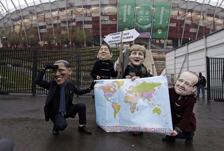 Protesters wearing masks of U.S. President Barack Obama (L-R), Japan's Prime Minister Shinzo Abe, German Chancellor Angela Merkel and France's President Francois Hollande, hold a map and a sign in front of the national stadium on the last day of the 19th conference of the United Nations Framework Convention on Climate Change (COP19) in Warsaw November 22, 2013. The event staged by Oxfam called on more decisive action from world leaders in 2014 after few concrete steps have emerged from two weeks of climate talks in Warsaw, according to media reports. (Kacper Pempel/REUTERS)