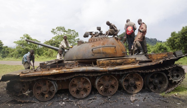 Congolese children play on a military tank, abandoned by the M23 rebel fighters who surrendered in Kibumba, near the eastern town of Goma. Democratic Republic of Congo's M23 rebel group on Tuesday called an end to a 20-month revolt after the army captured its last hilltop strongholds, raising hopes for peace in a region where millions have died in nearly two decades of violence. (Kenny Katombe/Reuters)