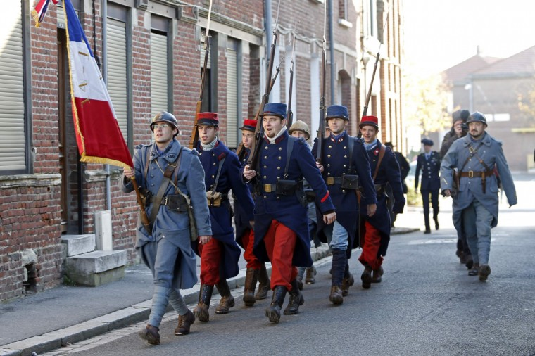 "World War One Historical Association ""14-18 en Somme"" members dressed as Poilu (French soldier in World War I) walk to the war memorial of Roye during the annual first World War remembrance ceremony in Northern France, November 11, 2013. The year 2014 will mark the centennial commemoration for the soldiers who fought in the First World War. (Charles Platiau/Reuters)"