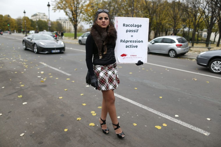 A sex worker activist attends a demonstration with prostitutes against a proposal to scrap sanctions on soliciting and instead punish prostitutes' customers with fines in Paris November 29, 2013. French lawmakers will start debating today a bill aimed at stemming prostitution with steep fines to clients - a radical switch from the country's traditionally tolerant stance that will give it some of the toughest legislation in Europe. Prostitution is not illegal in France, which has an estimated 18,000 to 20,000 sex workers according to a 2012 report by the Scelles Foundation, but there are laws against pimping, human trafficking and soliciting sex in public. (Charles Platiau/REUTERS)