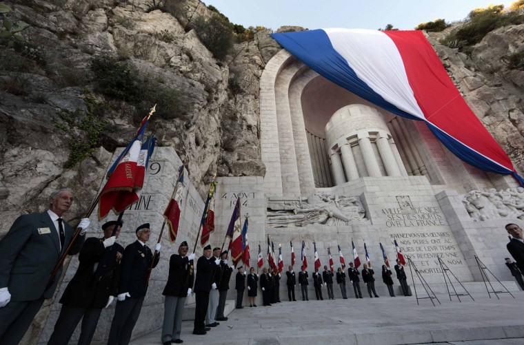 People hold up French national flags as they attend an Armistice ceremony at the war memorial in Nice November 11, 2013. The year 2014 will mark the centennial commemoration for the soldiers who fought in the First World War. (Eric Gaillard/Reuters)People hold up French national flags as they attend an Armistice ceremony at the war memorial in Nice November 11, 2013. The year 2014 will mark the centennial commemoration for the soldiers who fought in the First World War. (Eric Gaillard/Reuters)