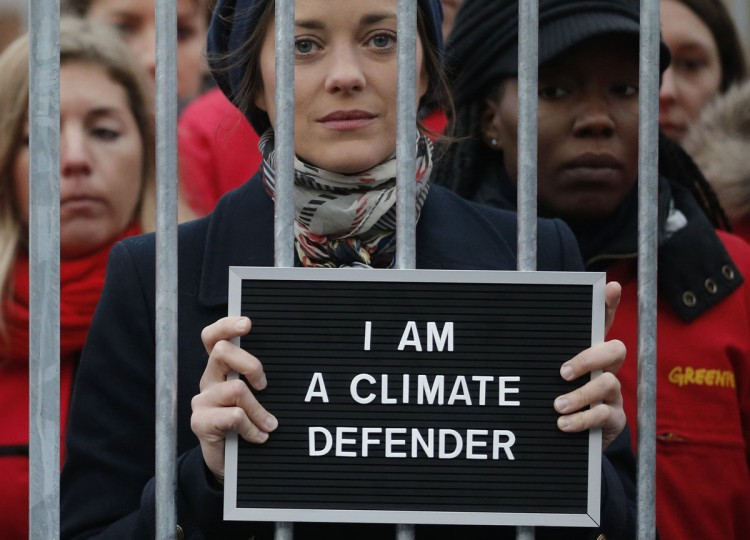 French actress Marion Cotillard (C) and Greenpeace activists protest inside a mock prison cell, in support of fellows activists who were detained on the boat Arctic Sunrise, during a protest action at Palais Royal place in Paris November 15, 2013. The group, consisting of 28 activists and two journalists, were arrested after coastguards boarded the Greenpeace icebreaker Arctic Sunrise following the protest at an oil platform owned by state-controlled Gazprom off Russia's northern coast on September 18. (Christian Hartmann/REUTERS)