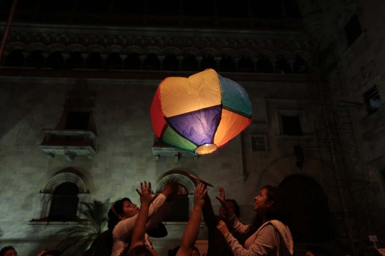 Women launch a paper hot air balloon during the annual demonstration to commemorate the International Day for the Elimination of Violence Against Women, in downtown Guatemala City, November 24, 2013. Organizers said around 696 women were killed in Guatemala in 2013. (Jorge Dan Lopez/Reuters)