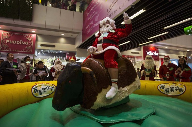A participant takes part in a competition, to determine who will represent Hong Kong at the annual Santa Claus Winter Games, at a shopping mall in Hong Kong November 1, 2013. Hong Kong won the championship in 2009 and came in second in 2012 for the international competition which will commence on November 23 in Gaellivare, Sweden. (Tyrone Siu/Reuters)