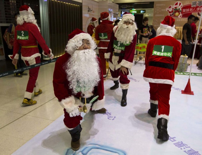 Participants warm up before taking part in a competition, to determine who will represent Hong Kong at the annual Santa Claus Winter Games, at a shopping mall in Hong Kong November 1, 2013. Hong Kong won the championship in 2009 and came in second in 2012 for the international competition which will commence on November 23 in Gaellivare, Sweden. (Tyrone Siu/Reuters)