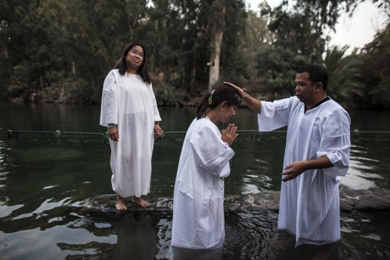 A Christian pilgrim is baptized in the water of the Jordan River during a ceremony at the Yardenit baptismal site near the northern Israeli city of Tiberias. Yardenit is one of the sites along the Jordan River where it is believed Jesus was baptized. (Nir Elias/Reuters)