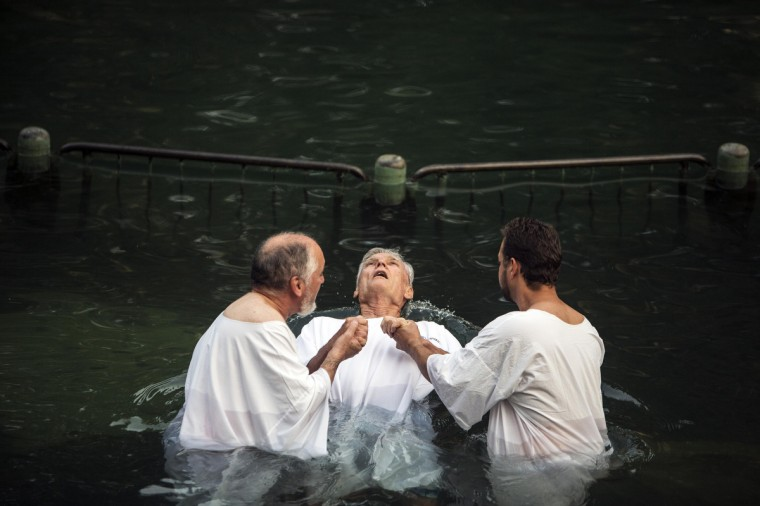 A Christian pilgrim from the U.S. is baptized in the water of the Jordan River during a ceremony at the Yardenit baptismal site near the northern Israeli city of Tiberias. Yardenit is one of the sites along the Jordan River where it is believed Jesus was baptized. (Nir Elias/Reuters)