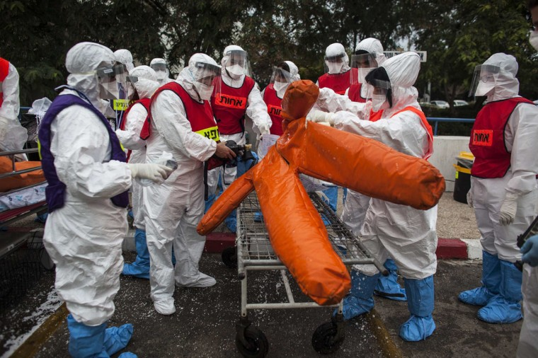 Israeli hospital staff wearing protective gear stand near a dummy as they take part in a drill simulating a radioactive incident at a hospital in Holon near Tel Aviv November 7, 2013. (Nir EliasREUTERS)