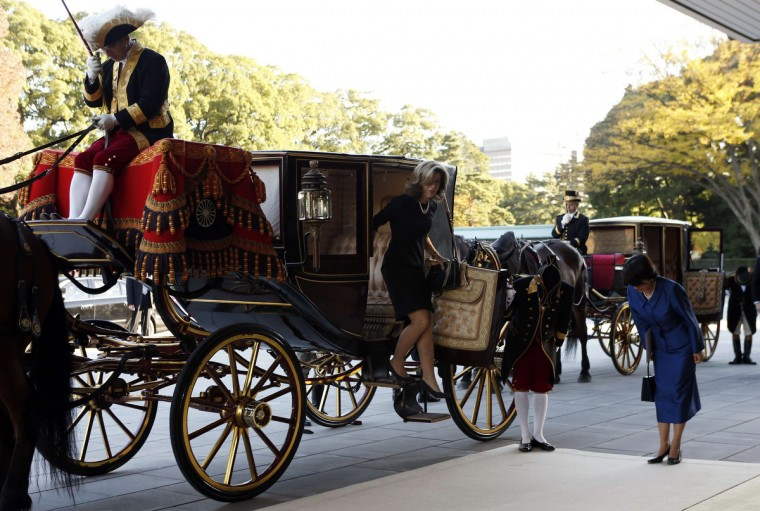 Newly appointed U.S. ambassador to Japan Caroline Kennedy (C) gets out of a horse-drawn carriage as she arrives at the Imperial Palace in Tokyo. (Issei Kato/Reuters)