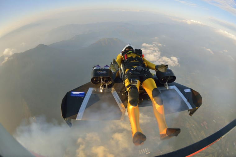 "Yves Rossy, known as the Jetman, drops from a helicopter to fly near Mount Fuji in this November 3, 2013 handout photograph released by Breitling SA. The Swiss aviator dropped from a helicopter and deployed the jet-powered carbon-kevlar ""Jetwing"" and uses his body to steer as he flew near Mt. Fuji nine times between October 28 and November 3. (Katsuhiko Tokunaga/REUTERS)"