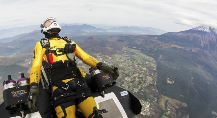 """Yves Rossy, known as the Jetman, drops from a helicopter to fly near Mount Fuji in this November 3, 2013 handout photograph released by Breitling SA. The Swiss aviator dropped from a helicopter and deployed the jet-powered carbon-kevlar """"Jetwing"""" and uses his body to steer as he flew near Mt. Fuji nine times between October 28 and November 3. (Katsuhiko Tokunaga/REUTERS)"""