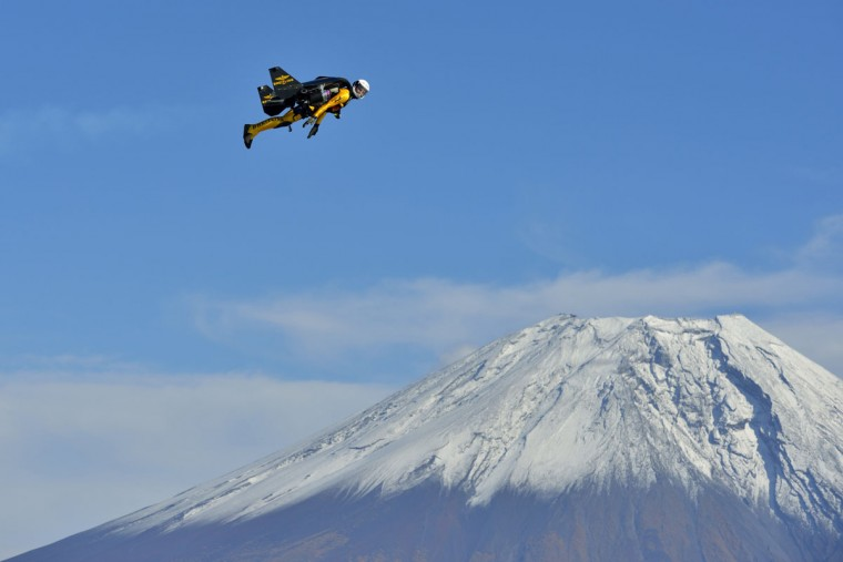 "Yves Rossy, known as the Jetman, flies in front of Mount Fuji in this October 30, 2013 handout photograph released by Breitling SA. The Swiss aviator dropped from a helicopter and deployed the jet-powered carbon-kevlar ""Jetwing"" and uses his body to steer as he flew near Mt. Fuji nine times between October 28 and November 3. (Katsuhiko Tokunaga/REUTERS)"