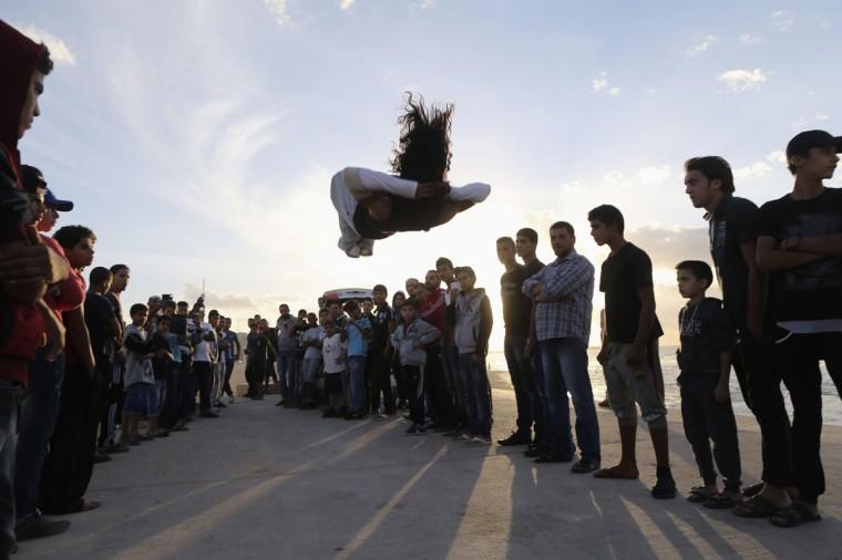 Young Libyans practise parkour on the beach in Benghazi November 22, 2013. (Esam Omran Al-Fetori/REUTERS)