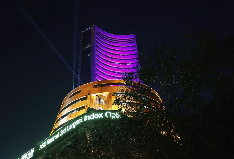 The Bombay Stock Exchange (BSE) building is illuminated during the Diwali special trading session celebrating the annual Hindu festival of lights in Mumbai November 3, 2013. India's benchmark BSE share index rose to a second consecutive record high in a special trading session on Sunday, led by gains in Indian Bank, Tata Motors and ONGC on expectations of better quarterly earnings, while strong foreign flows continued to boost sentiment. (Danish Siddiqui/Reuters)