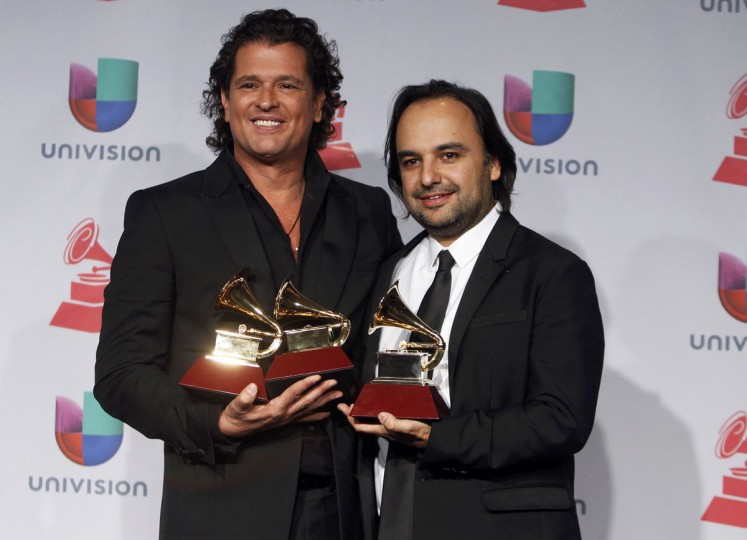 Carlos Vives, left, shares the Song of the Year award for Volvi A Nacer with Andres Castrol during the 14th Latin Grammy Awards in Las Vegas. Vives also holds his Best Tropical Fusion Album award for Corazon Profundo and Best Tropical Song award for Volvi A Nacer. (REUTERS/Steve Marcus)