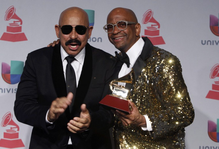 """Oscar DeLeon and Silvio George, right, pose with the award for best salsa album for """"Sergio George Presents Salsa Giants"""" backstage during the 14th Latin Grammy Awards in Las Vegas. (REUTERS/Steve Marcus)"""