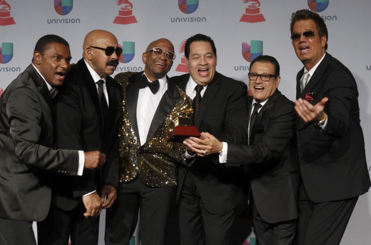 """Silvio George poses with the award for best salsa album for """"Sergio George Presents Salsa Giants"""" along with (From left:) Jose Canario, Oscar DeLeon, George, Tito Nieves, Luis Enrique and Willy Chirino, backstage during the 14th Latin Grammy Awards in Las Vegas. (REUTERS/Steve Marcus)"""