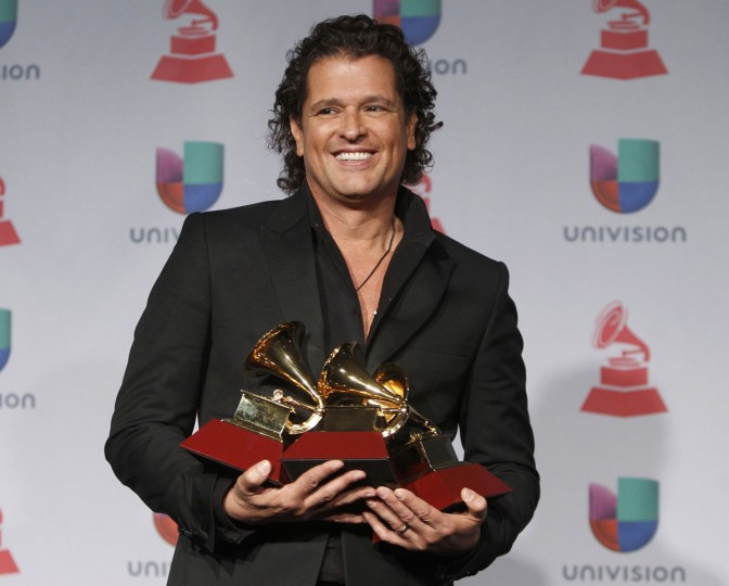 """Carlos Vives poses with his awards for best tropical fusion album for """"Corazon Profundo"""" and for best tropical song and for song of the year for """"Volvi A Nacer,"""" backstage during the 14th Latin Grammy Awards in Las Vegas. (REUTERS/Steve Marcus)"""