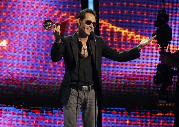 """Marc Anthony accepts the award for record of the year for """"Vivir Mi Vida"""" onstage during the 14th Latin Grammy Awards in Las Vegas. (REUTERS/Mario Anzuoni)"""
