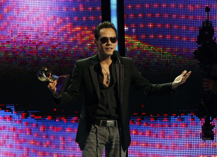 "Marc Anthony accepts the award for record of the year for ""Vivir Mi Vida"" onstage during the 14th Latin Grammy Awards in Las Vegas. (REUTERS/Mario Anzuoni)"