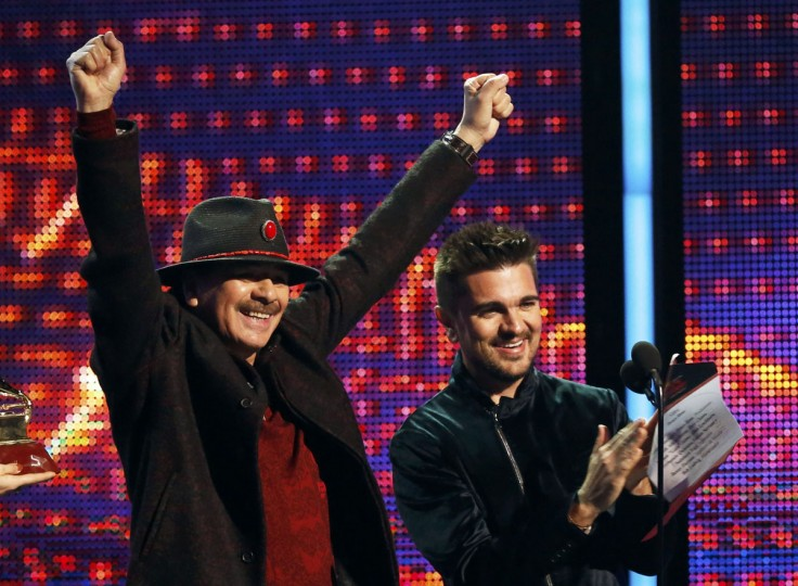 Santana, left, and Juanes present the Album of the Year award during the 14th Latin Grammy Awards in Las Vegas. (REUTERS/Mario Anzuoni)
